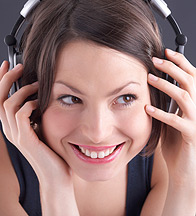 Woman Listening to Music in Headphones