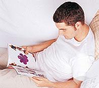 Man Reading Glossy Magazine