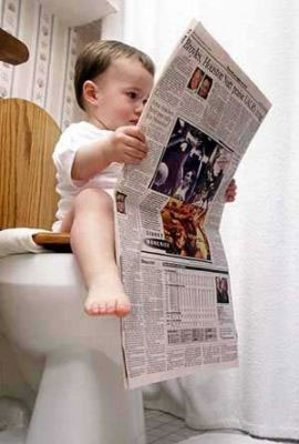 Boy Reading a Paper in WC