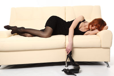 Woman, sofa, shoes off