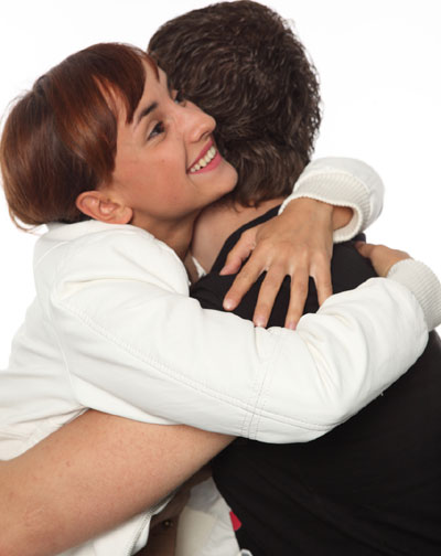 Woman hugging man
