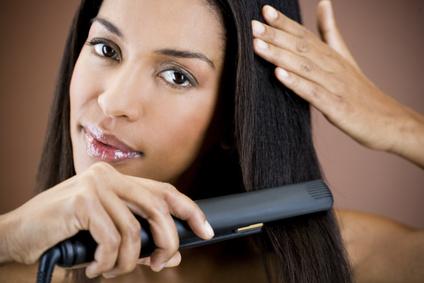 woman straightening hair