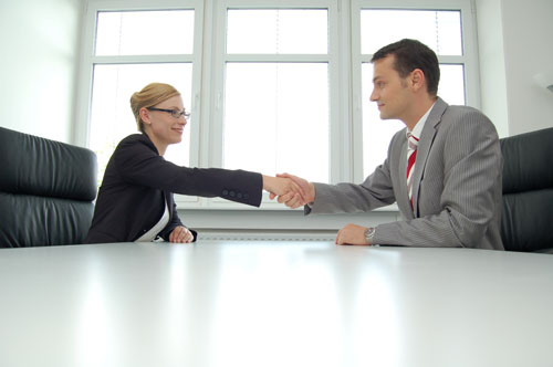 Yound Woman at a Job Interview with her future Boss