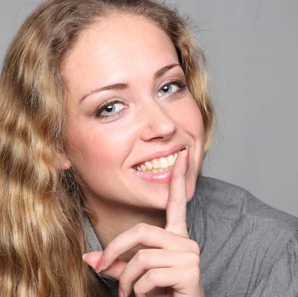 silence-woman-finger-face-smile-secret