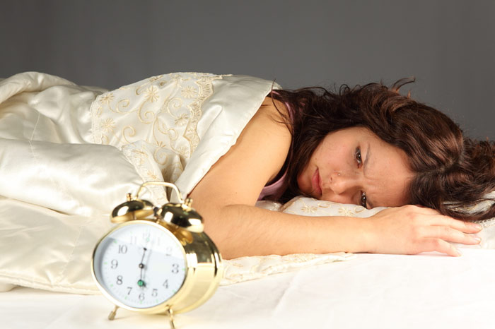 700-woman-sleep-boring-tired-bed-wakeup-morning-night-alarm-clock