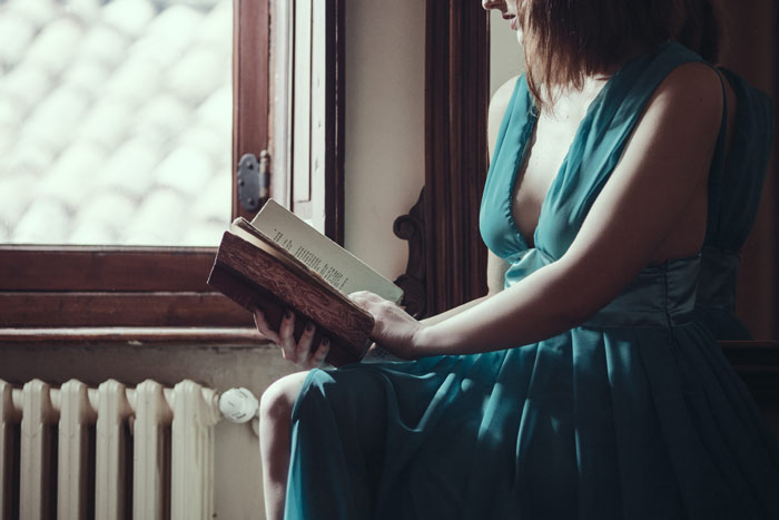 woman-breast-read-book-home-dress