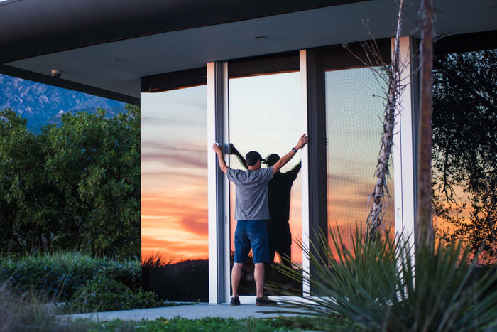 home-moving-man-sunset-house
